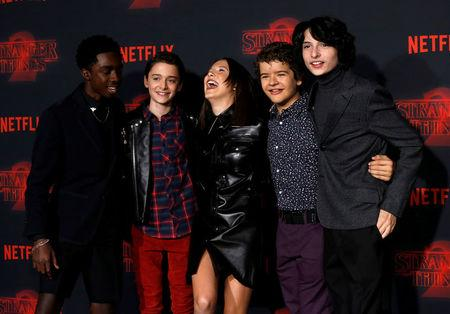 """FILE PHOTO: Cast members McLaughlin, Schnapp, Brown, Matarazzo and Wolfhard pose at the premiere for the second season of the television series """"Stranger Things"""" in Los Angeles"""