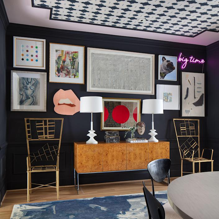 """In the dining room, a vintage credenza topped with Mr. Brown lamps is flanked by vintage chairs from interior designer Kelly Wearstler's Beverly Hills home. Lindsay created a gallery wall to highlight some of her favorite pieces by artists Holly Addi, Addie Chapin, Susan Carter Hall, and Angela Chrusciaki Blehm. """"That gallery wall went through many iterations,"""" she says. """"It's about finding the right place for them and creating the right tension between the art."""""""