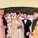 <p>Prime Minister Modi shares a joke with the newly-weds </p>