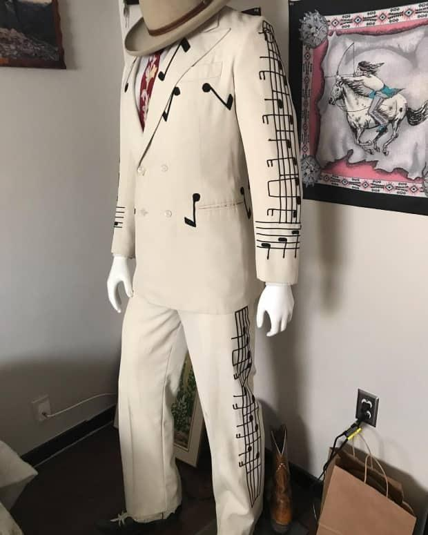 """This suit is said to have been worn by Sneezy Waters in the 1980 Hank William's film """"The Show He Never Gave"""". It will be on display in the tiny home honky tonk."""
