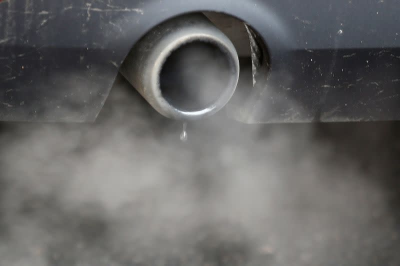 FILE PHOTO: An exhaust emits fumes as a car is driven through Richmond in London