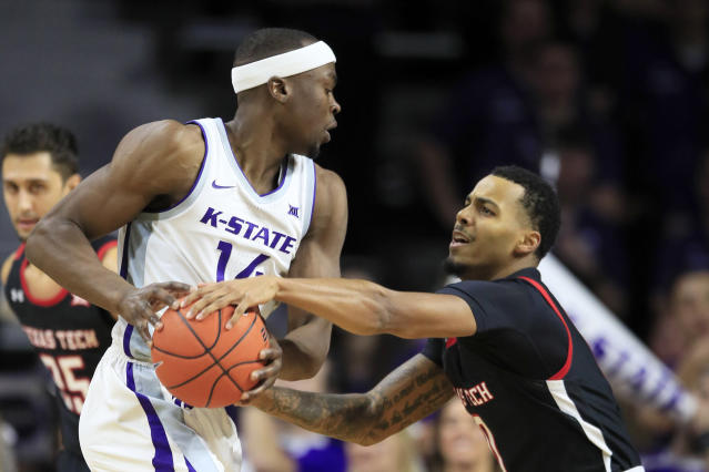 Kansas State forward Makol Mawien (14) is covered by Texas Tech guard Kyler Edwards, right, during the first half of an NCAA college basketball game in Manhattan, Kan., Tuesday, Jan. 14, 2020. (AP Photo/Orlin Wagner)