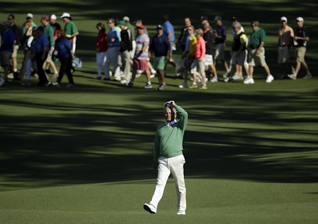 Fred Couples walks down the second fairway during the first round of the Masters golf tournament Thursday, April 10, 2014, in Augusta, Ga. (AP Photo/Chris Carlson)