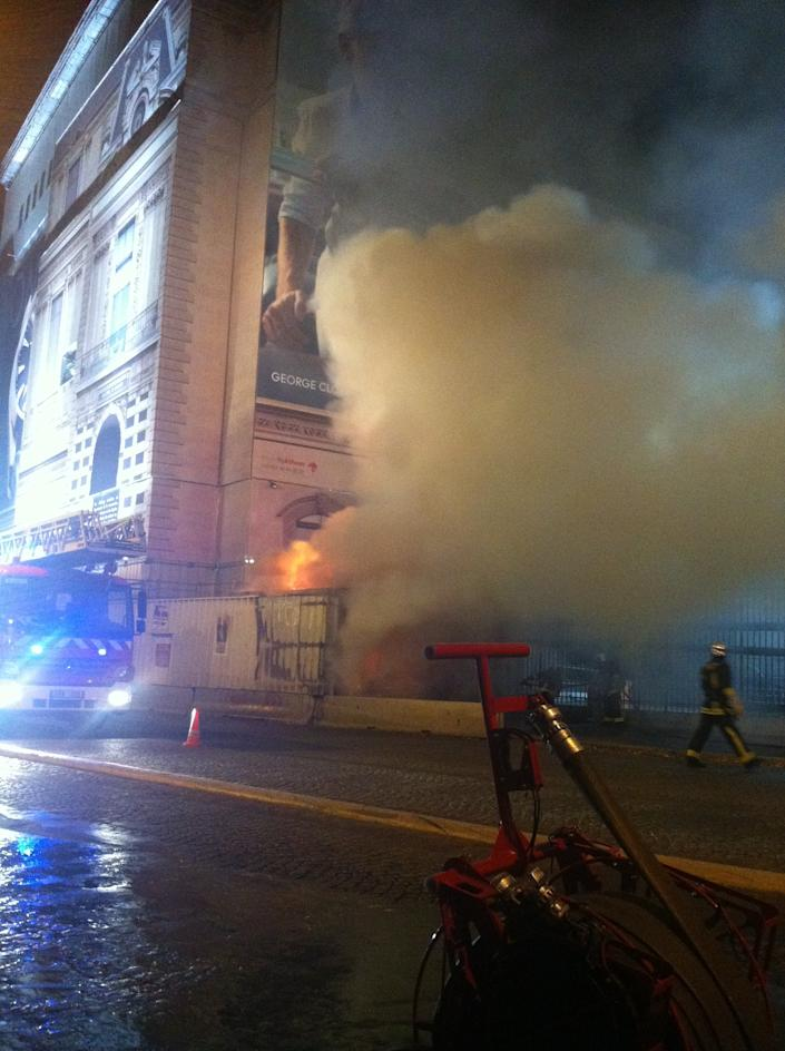 """Flames threatened the Louvre in Paris on October 3, when a construction and renovation trailer caught fire. """"The museum itself wasn't damaged,"""" passing photographer, Marie Desgre, told Yahoo! """"But it was impressive at the moment!"""" (Photo: Marie Desgre)"""