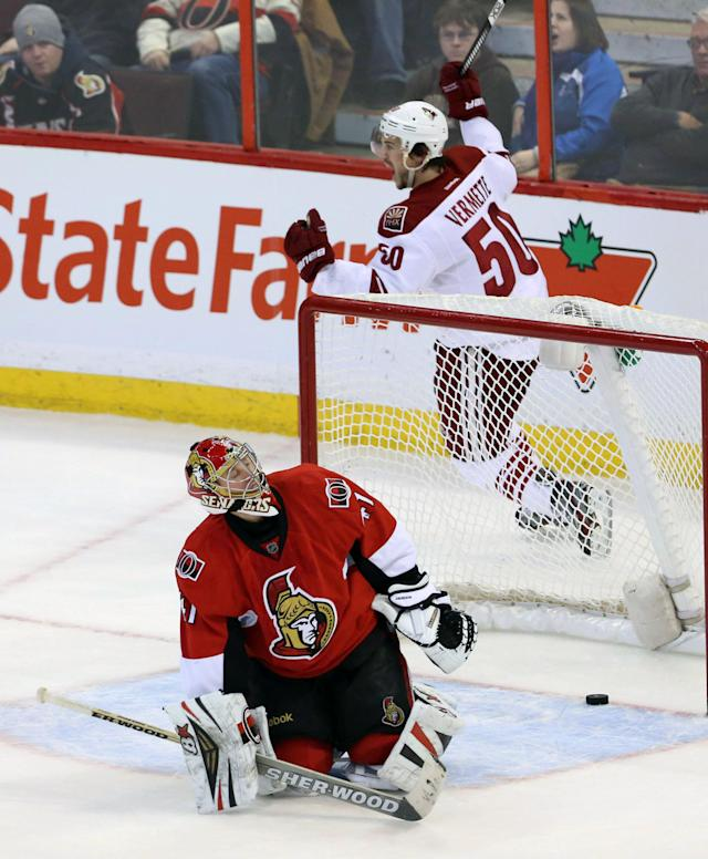 Ottawa Senators goaltender Craig Anderson looks on as Phoenix Coyotes Antoine Vermette (50) celebrates his winning goal during NHL overtime action beating the Ottawa Senators 4-3 in Ottawa Saturday, Dec. 21, 2013. (AP Photo/The Canadian Press, Fred Chartrand)