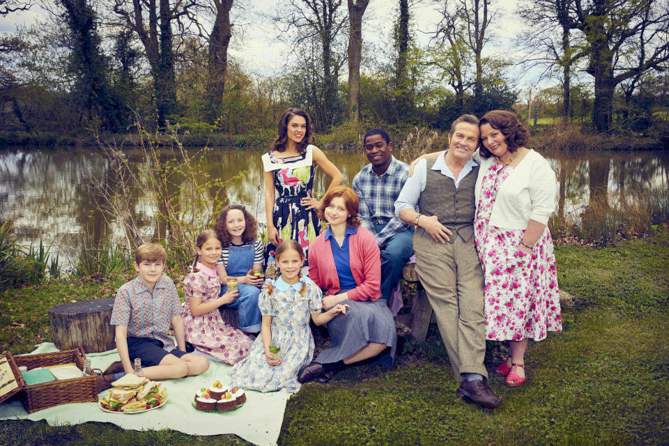This image and the information contained herein is strictly embargoed until 00.01 Thursday 30th September 2021From Objective Fiction / Genial ProductionsThe Larkins on ITV and ITV HubPictured: Montgomery Larkin [Liam Middleton], Petunia Larkin [Rosie Coleman],Victoria Larkin [Lola Shepelev], Zinnia Larkin [Davina Coleman], Mariette [Sabrina Bartlett], Primrose Larkin [Lydia Page], Charley [Tok Stephen], Pop Larkin [Bradley Walsh] and Ma Larkin [Joanna Scanlan].This photograph is (C) ITV Plc / Objective Fiction / Genial Productions and can only be reproduced for editorial purposes directly in connection with the programme or event mentioned above, or ITV plc. Once made available by ITV plc Picture Desk, this photograph can be reproduced once only up until the transmission [TX] date and no reproduction fee will be charged. Any subsequent usage may incur a fee. This photograph must not be manipulated [excluding basic cropping] in a manner which alters the visual appearance of the person photographed deemed detrimental or inappropriate by ITV plc Picture Desk.  This photograph must not be syndicated to any other company, publication or website, or permanently archived, without the express written permission of ITV Picture Desk. Full Terms and conditions are available on the website www.itv.com/presscentre/itvpictures/termsFor further information please contact:james.hilder@itv.com / 0207 157 3052n