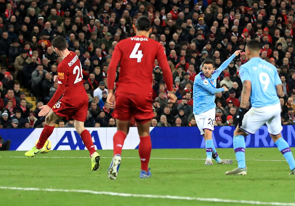 Manchester City's Bernardo Silva (centre right) scores his side's first goal of the game during the Premier League match at Anfield, Liverpool. (Photo by Peter Byrne/PA Images via Getty Images)
