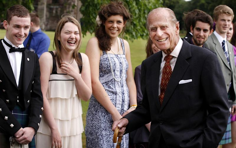 With Duke of Edinburgh Gold Award holders. The scheme has been one of his achievements  - Getty Images Europe