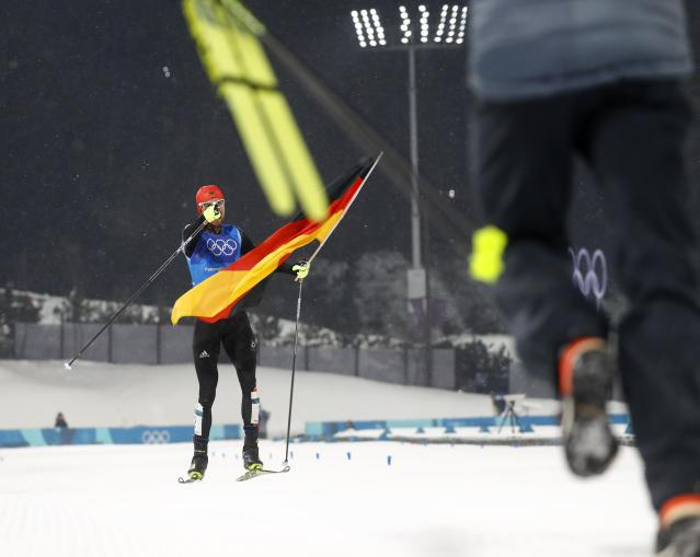 Nordic Combined Events - Pyeongchang 2018 Winter Olympics - Men's Team 4 x 5 km Final - Alpensia Cross-Country Skiing Centre - Pyeongchang, South Korea - February 22, 2018 - Johannes Rydzek of Germany celebrates with the German flag after winning. REUTERS/Kai Pfaffenbach