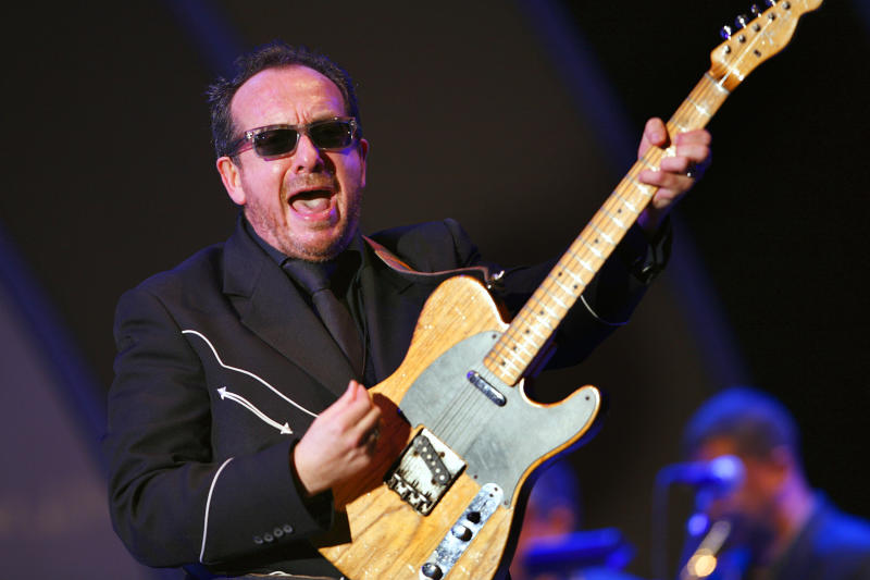 "FILE - This is a Sunday June 18, 2006 file photo of Elvis Costello as performs with Allen Toussaint and the New Orleans Horn Section during the Playboy Jazz Festival in Los Angeles, Calif. Costello was critical of Margaret Thatcher's government in the 1980's in the song ""Tramp the Dirt Down,"" Former British Prime Minister Margaret Thatcher, whose conservative ideas made an enduring impact on Britain died Monday April 8, 2013. She was 87. (AP Photo/Lucas Jackson, File)"