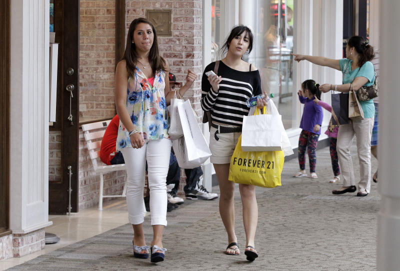 FILE-In this Wednesday, May 30, 2012, photo, shoppers walk through the South Shore Mall in Braintree, Mass. U.S. retail sales declined in April and May, pulled down by a sharp drop in gas prices. But even after excluding volatile gas sales, consumers increased their spending only modestly. (AP Photo/Stephan Savoia, File)