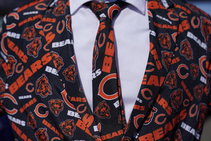 A Chicago Bears fan tailgates before an before an NFL football game against the Los Angeles Rams at SoFi Stadium Sunday, Sept. 12, 2021, in Inglewood, Calif. (AP Photo/Jae C. Hong)