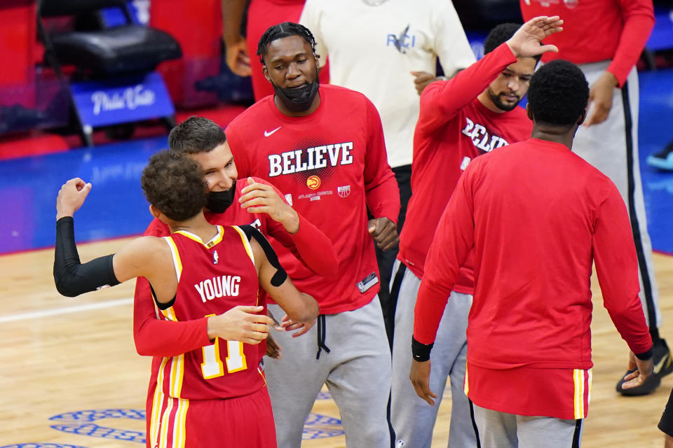 Atlanta Hawks' Trae Young, left, and Bogdan Bogdanovic embrace after the Hawks won Game 5 in a second-round NBA basketball playoff series against the Philadelphia 76ers, Wednesday, June 16, 2021, in Philadelphia. (AP Photo/Matt Slocum)