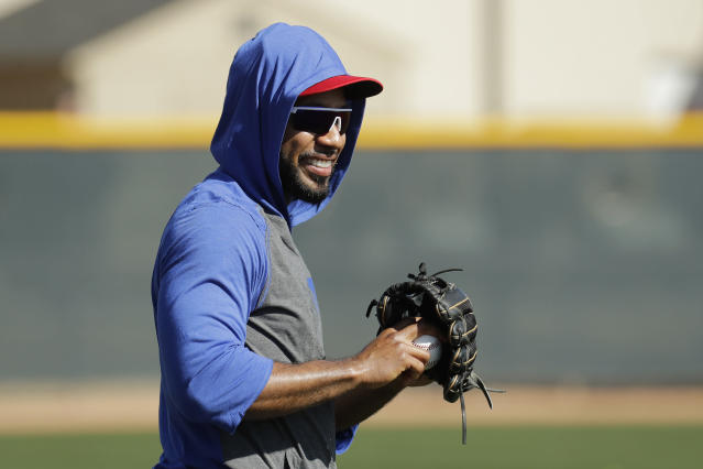 Texas Rangers' Elvis Andrus watches a drill during spring training baseball practice Monday, Feb. 17, 2020, in Surprise, Ariz. (AP Photo/Charlie Riedel)