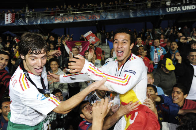 Spanish players Ruben Perez (L) and second goal scorer Thiago Alcantara celebrate at the end of the UEFA Under-21 European Championship final match Spain vs Switzerland at the Aarhus Stadium, on June 25, 2011. Spain win the final with 2-0.AFP PHOTO/JONATHAN NACKSTRAND (Photo credit should read JONATHAN NACKSTRAND/AFP/Getty Images)