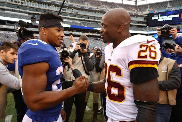 "<a class=""link rapid-noclick-resp"" href=""/nfl/players/8261/"" data-ylk=""slk:Adrian Peterson"">Adrian Peterson</a> officially met <a class=""link rapid-noclick-resp"" href=""/nfl/teams/nyg"" data-ylk=""slk:New York Giants"">New York Giants</a> running back <a class=""link rapid-noclick-resp"" href=""/nfl/players/30972/"" data-ylk=""slk:Saquon Barkley"">Saquon Barkley</a> on Sunday, and had some advice for the rookie. (Getty Images)"