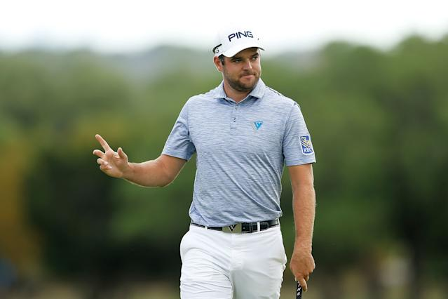 """<h1 class=""""title"""">corey-conners-2019-wave-valero-texas-open-sunday.jpg</h1> <div class=""""caption""""> Conners waves to fans during his victory march at the 2019 Valero Texas Open. </div> <cite class=""""credit"""">Michael Reaves</cite>"""