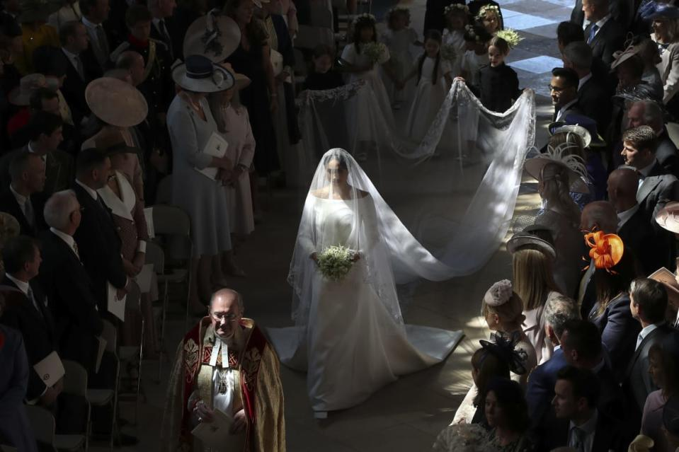 "<div class=""inline-image__caption""><p>Meghan Markle walks down the aisle in St George's Chapel, Windsor Castle, in Windsor, on May 19, 2018 during her wedding to Britain's Prince Harry, Duke of Sussex.</p></div> <div class=""inline-image__credit"">Danny Lawson/Getty</div>"