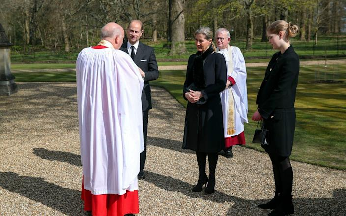 The Earl and Countess of Wessex, with their daughter Lady Louise Windsor, talk to Cannon Martin Poll, Domestic Chaplin to Her Majesty The Queen, - Steve Parsons
