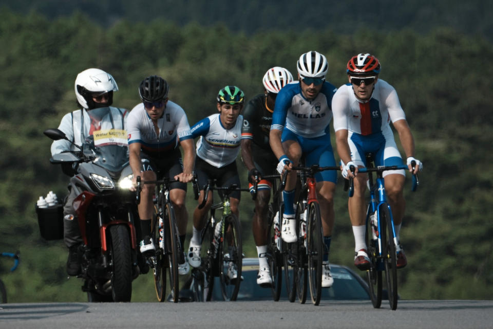 Riders in the breakaway climb during the men's cycling road race at the 2020 Summer Olympics, Saturday, July 24, 2021, in Oyama, Japan. (AP Photo/Thibault Camus)