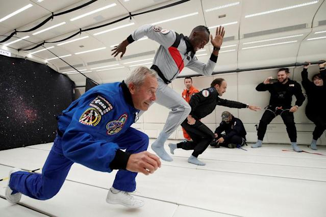 """Retired sprinter Usain Bolt, French astronaut Jean-Francois Clervoy, CEO of Novespace and French Interior designer Octave de Gaulle who designed a bottle of """"Mumm Grand Cordon Stellar"""" enjoy zero gravity conditions during a flight in a specially modified Airbus Zero-G plane above Reims, France, September 12, 2018. REUTERS/Benoit Tessier"""