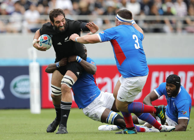 New Zealand's Samuel Whitelock looks to fend off Namibia's AJ De Klerk, right, during the Rugby World Cup Pool B game at Tokyo Stadium between New Zealand and Namibia in Tokyo, Japan, Sunday, Oct. 6, 2019. (AP Photo/Christophe Ena)