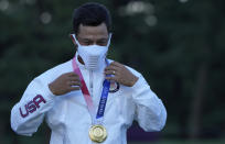 Xander Schauffele of the United States poses with his Gold in the Men's Golf event at the 2020 Summer Olympics on Sunday, Aug. 1, 2021, in Kawagoe, Japan.. (AP Photo/Andy Wong)