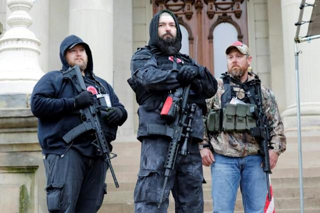 Booglaoo supporters have joined armed protests against the coronavirus shutdown, like this demonstration in Lansing, Michigan on April 30, 2020. (AFP Photo/JEFF KOWALSKY)