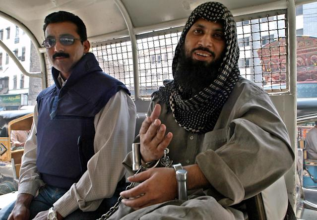 <p>Pakistani suspected Islamic militant Mohammed Sohail, right, is accompanied by unidentified police officer, left, while leaving a court in Karachi, Pakistan on Monday, March 7, 2005. Sohail, who is in police custody in the slaying of Wall Street Journal reporter Daniel Pearl is not cooperating with interrogators, an official said. (AP Photo/Shakil Adil) </p>