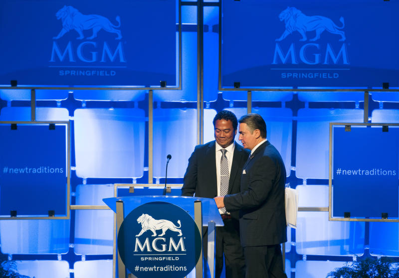 FILE - In this Aug. 23, 2018 file photo, Springfield Mayor Domenic J. Sarno, right, and MGM Springfield President Michael C. Mathis attend a press conference for the grand opening of the $960 million casino  in Springfield, Mass.   Massachusetts' first Las Vegas-style casino is throwing itself a birthday bash, Saturday, Aug. 24, 2019, with Aerosmith, New England Patriots cheerleaders and a five-tier cake. But one year after opening, MGM Springfield has underperformed and shed hundreds of jobs. Some business owners also say the promised downtown revival hasn't materialized. (Greg Saulmon /The Republican via AP)