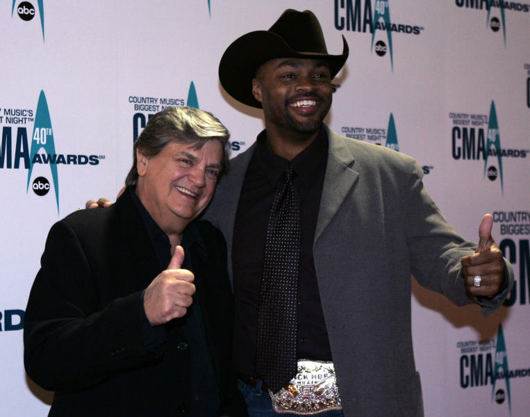 FILE - In this Nov. 6, 2006 file photo, Phil Everly, left, and Cowboy Troy arrive at the 40th Annual CMA Awards in Nashville, Tenn. Everly, who with his brother Don formed an influential harmony duo that touched the hearts and sparked the imaginations of rock 'n' roll singers for decades, including the Beatles and Bob Dylan, died Friday, Jan. 3, 2014. He was 74. Everly died of chronic obstructive pulmonary disease at a Burbank hospital, said his son Jason Everly. (AP Photo/Chitose Suzuki, File)
