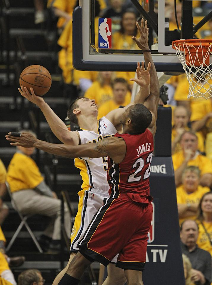 INDIANAPOLIS, IN - MAY 17: Tyler Hansbrough #50 of the Indiana Pacers pushes off James Jones #22 of the Miami Heat as he tries to shoot in Game Three of the Eastern Conference Semifinals in the 2012 NBA Playoffs at Bankers Life Fieldhouse on May 17, 2012 in Indianapolis, Indiana. NOTE TO USER: User expressly acknowledges and agrees that, by downloading and/or using this photograph, User is consenting to the terms and conditions of the Getty Images License Agreement. (Photo by Jonathan Daniel/Getty Images)