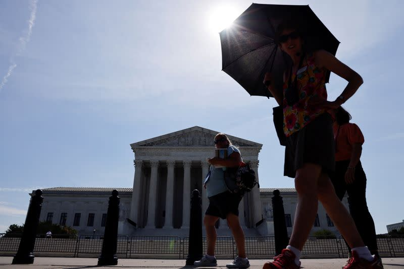 FILE PHOTO: A tour group walks past the front of the U.S. Supreme Court building in Washington