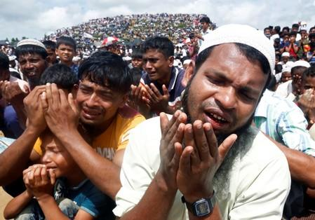 Rohingya refugees take part in a prayer as they gather to mark the second anniversary of the exodus at the Kutupalong camp in Cox's Bazar