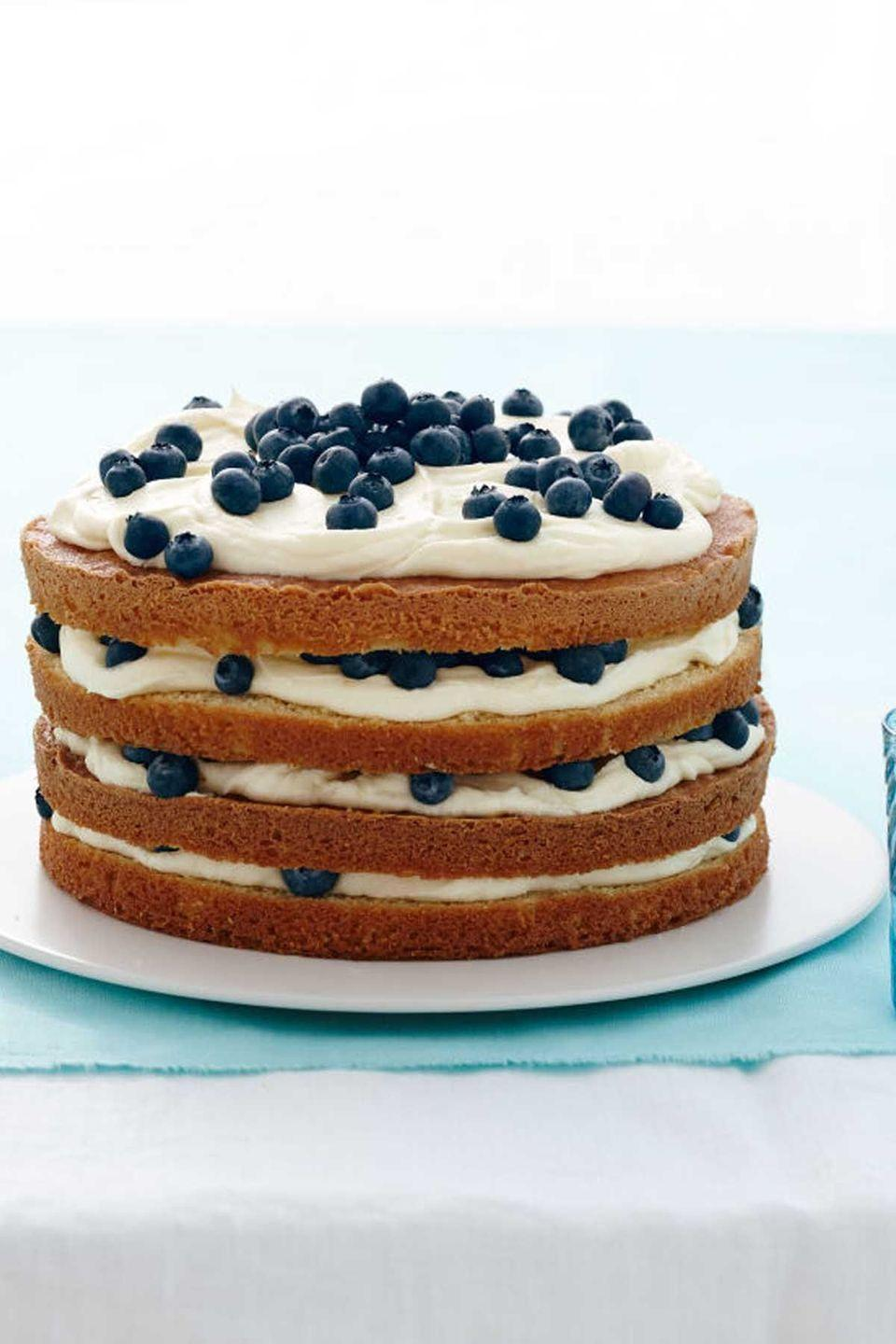 """<p>This naked cake might look simple, but the lemon frosting and fresh blueberries will be far from boring for your taste buds.</p><p><strong><em><a href=""""https://www.womansday.com/food-recipes/food-drinks/recipes/a13417/lemon-blueberry-layer-cake-recipe-wdy0414/"""" rel=""""nofollow noopener"""" target=""""_blank"""" data-ylk=""""slk:Get the Lemon Blueberry Layer Cake recipe."""" class=""""link rapid-noclick-resp"""">Get the Lemon Blueberry Layer Cake recipe. </a></em></strong><br></p>"""