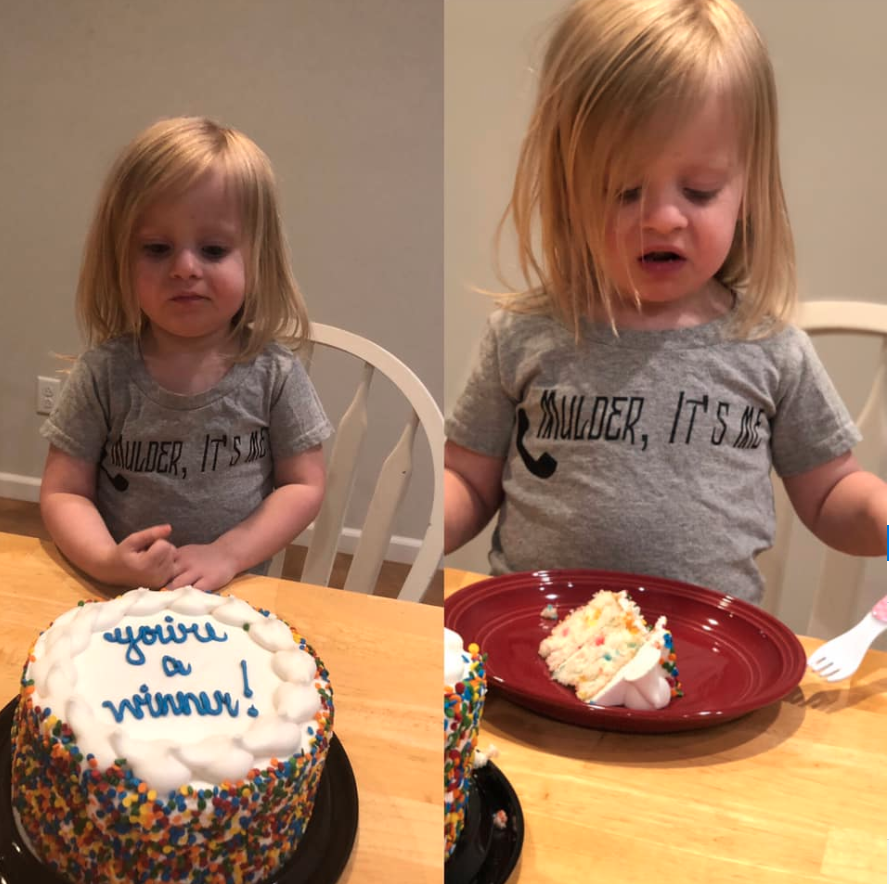 Little girl with 'You're a Winner' cake