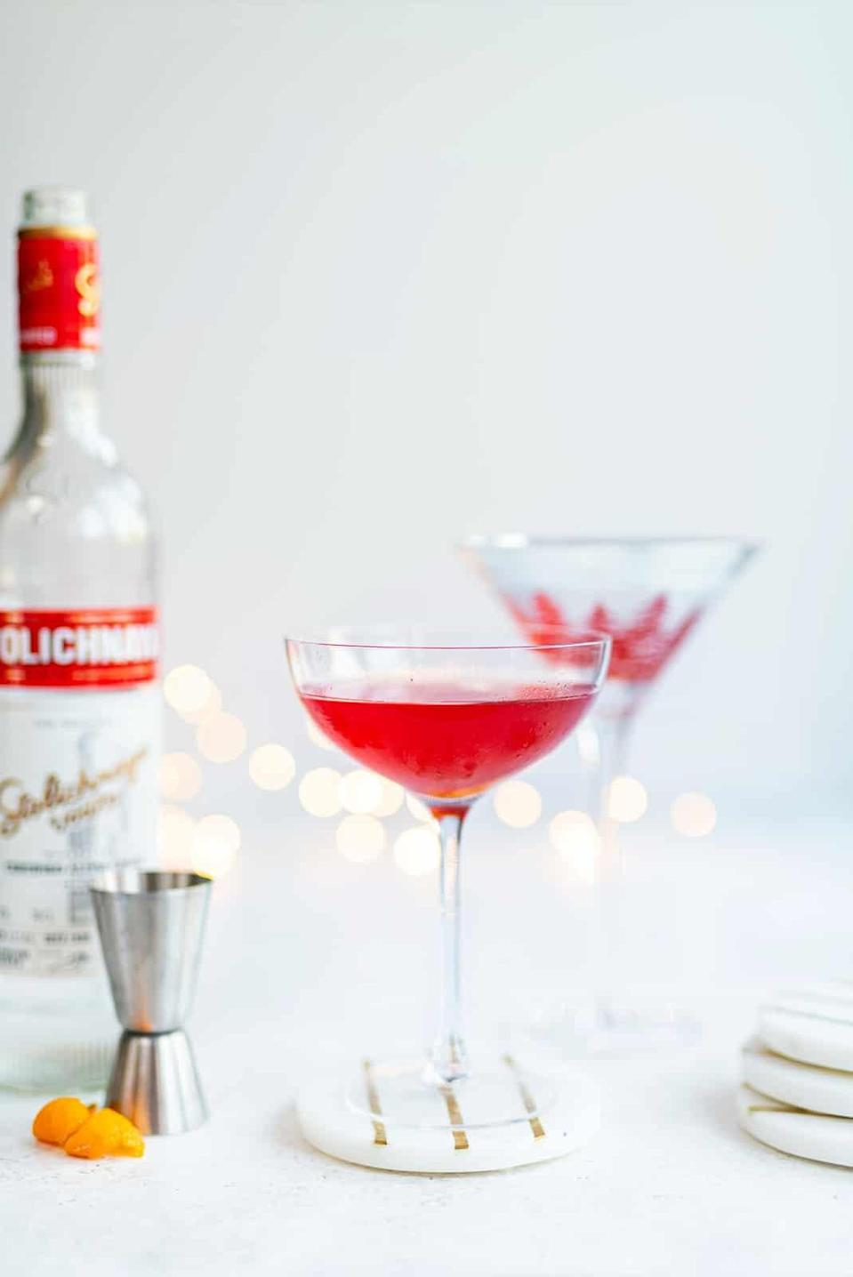 """<p>Classic, classy, and <strong>Sex and the City</strong>-approved, cosmopolitans are the chic drink of your dreams. The mix of vodka, orange liqueur, cranberry, and lime juice will leave your head in the clouds.</p> <p><strong>Get the recipe</strong>: <a href=""""https://www.popsugar.com/buy?url=https%3A%2F%2Fwww.supergoldenbakes.com%2Fcocktail-friday-blood-orange%2F&p_name=cosmopolitan&retailer=supergoldenbakes.com&evar1=yum%3Aus&evar9=47471653&evar98=https%3A%2F%2Fwww.popsugar.com%2Ffood%2Fphoto-gallery%2F47471653%2Fimage%2F47474526%2FMichigan-Cosmopolitan&list1=cocktails%2Cdrinks%2Calcohol%2Crecipes&prop13=api&pdata=1"""" class=""""link rapid-noclick-resp"""" rel=""""nofollow noopener"""" target=""""_blank"""" data-ylk=""""slk:cosmopolitan"""">cosmopolitan</a></p>"""