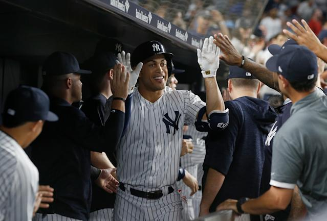 The fan who caught New York Yankees slugger Giancarlo Stanton's 300th home run on Thursday night traded it in for free beer, among other things. (Getty Images)