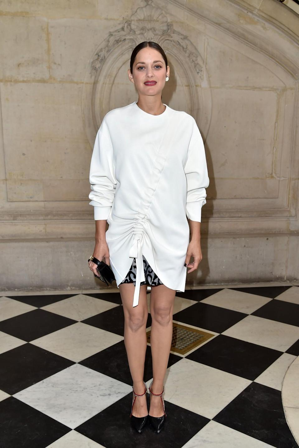 <p>Although knitwear usually comes in two categories (super tight or super unflattering), there are some styles that will take the emphasis away from your stomach. Take a cue from Marion's rushed Dior style and invest in some detailed knits. <i>[Photo: Getty]</i> </p>