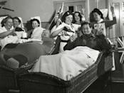 <p>Patients at Horley Military Hospital, all severely wounded in France and Italy, celebrate V-E Day with nursing staff.</p>