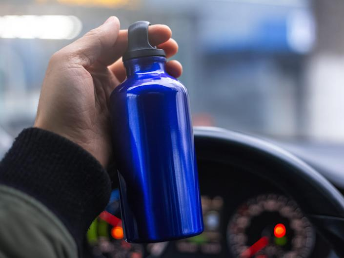 stainless steel water bottle in the car