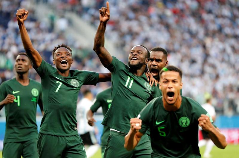 On target: Moses celebrates with team-mates after scoring Nigeria's equaliser (REUTERS)