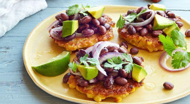 "<p>Think beyond the cob with these Tex-Mex fritters. Served with a bright, black bean salad, they make for the tastiest summer dinner. Optional: a frosty <a href=""https://www.goodhousekeeping.com/food-recipes/a13731/guilt-free-margaritas-recipe-clv1012/"" rel=""nofollow noopener"" target=""_blank"" data-ylk=""slk:margarita"" class=""link rapid-noclick-resp"">margarita</a>.</p><p><a href=""https://www.goodhousekeeping.com/food-recipes/a15369/corn-fritters-black-bean-salad-recipe-ghk0914/"" rel=""nofollow noopener"" target=""_blank"" data-ylk=""slk:Get the recipe for Corn Fritters with Black Bean Salad »"" class=""link rapid-noclick-resp""><em>Get the recipe for Corn Fritters with Black Bean Salad »</em></a></p>"