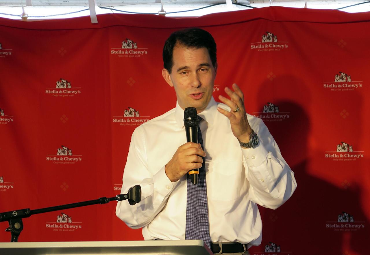 Wisconsin Gov. Scott Walker speaks at a campaign appearance Thursday, June 12, 2014, in Oak Creek, Wis. Walker, who is running for re-election this year and eyeing a bid for president in 2016, said afterward that his personal opposition to same-sex marriage doesn't matter because the ban on gay marriage was put into the state constitution by a vote of the people. A federal judge last week struck down the state's ban on same-sex marriages. (AP Photo/Carrie Antlfinger)