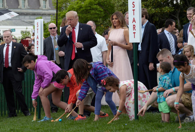 President Donald Trump, accompanied by first lady Melania Trump, blows a whistle to begin an Easter Egg Roll race on the South Lawn of the White House in Washington during the annual White House Eastern Egg Roll. Trump and his wife, Melania, are hosting festivities Monday, April 2, 2018, on the South Lawn for a crowd of nearly 30,000 adults and children. (AP Photo/Susan Walsh)