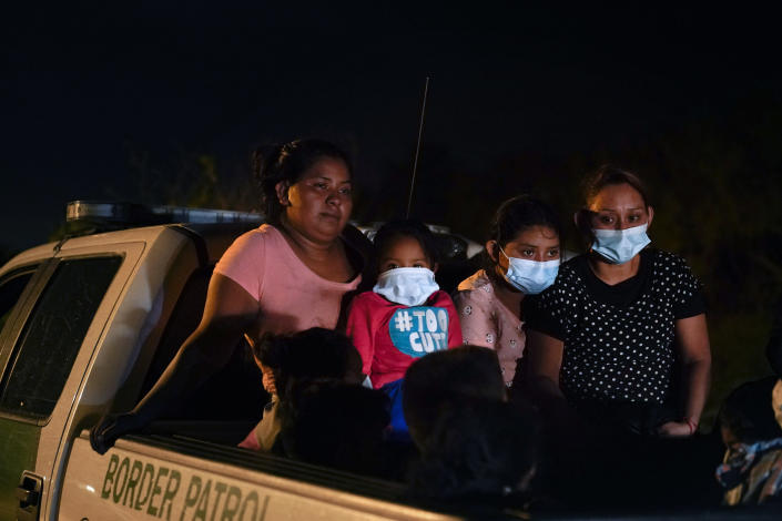 Migrants from Honduras wait in a Border Patrol truck after turning themselves in upon crossing the U.S.-Mexico border Monday, May 17, 2021, in La Joya, Texas. The Biden administration has agreed to let up to about 250 people a day in the United States at border crossings with Mexico to seek refuge, part of negotiations to settle a lawsuit over pandemic-related powers that deny migrants a right to apply for asylum, an attorney said Monday. (AP Photo/Gregory Bull)