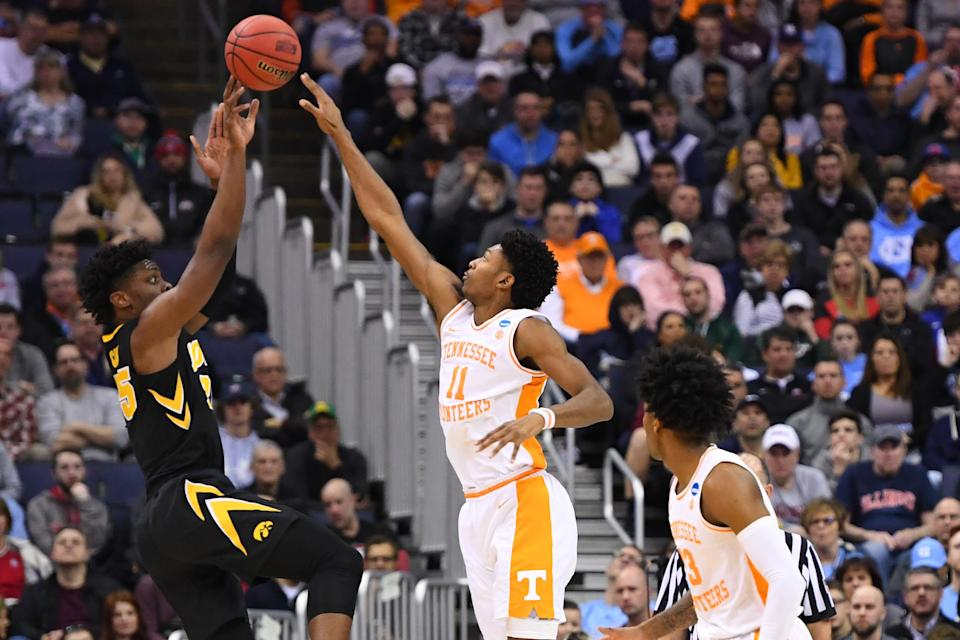 <p>Tyler Cook #25 of the Iowa Hawkeyes shoots over Kyle Alexander #11 of the Tennessee Volunteers in the second round of the 2019 NCAA Men's Basketball Tournament held at Nationwide Arena on March 24, 2019 in Columbus, Ohio. (Photo by Jamie Schwaberow/NCAA Photos via Getty Images) </p>