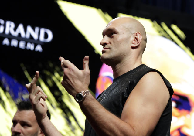 Tyson Fury, of England, gestures during a weigh-in for his WBC heavyweight championship boxing match against Deontay Wilder, Friday, Feb. 21, 2020, in Las Vegas. (AP Photo/Isaac Brekken)