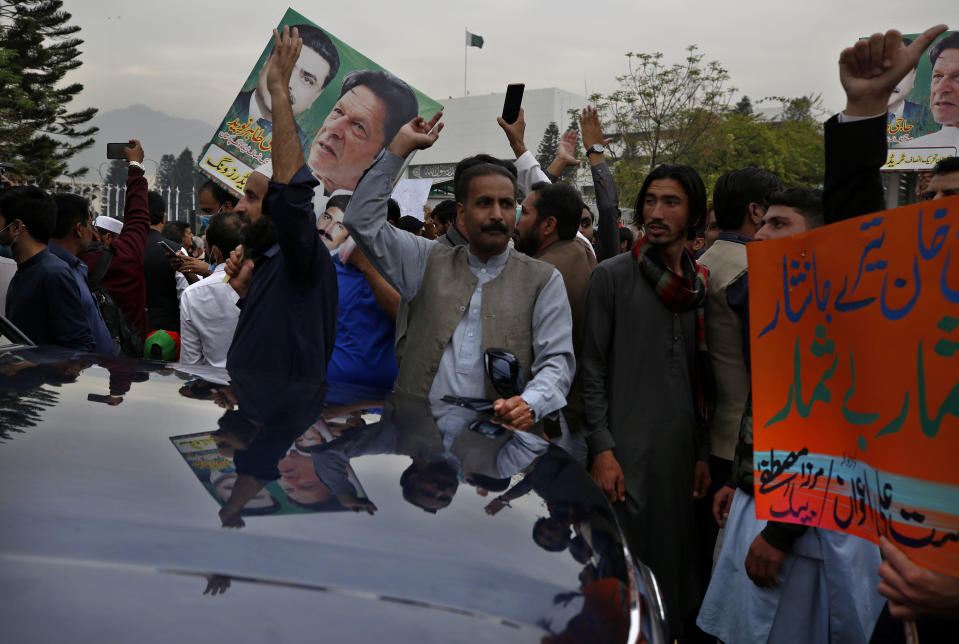 Supporters of the ruling Pakistan Tehree-e-Insaf political party gather outside the National Assembly to celebrate Prime Minister Imran Khan winning a vote of confidence in Islamabad, Pakistan, Saturday, March 6, 2021. Khan handily won a vote of confidence from the National Assembly on Saturday, days after the embarrassing defeat of his ruling party's key candidate in Senate elections. (AP Photo/Anjum Naveed)