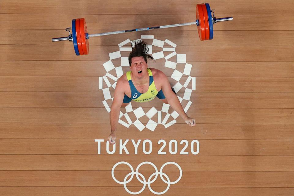 <p>Australia's Matthew Ryan Lydement reacts after missing an attempt during the men's 109kg weightlifting competition during the Tokyo 2020 Olympic Games at the Tokyo International Forum in Tokyo on August 3, 2021. (Photo by Alexander NEMENOV / POOL / AFP)</p>